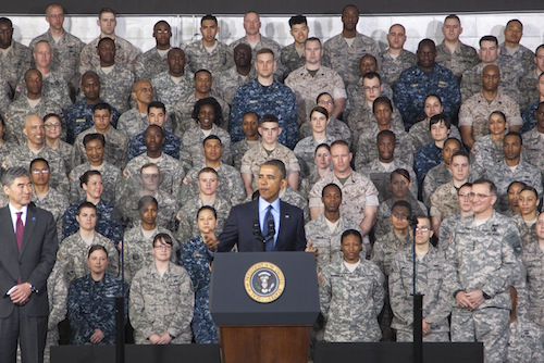 YONGSAN, South Korea (Apr. 26, 2014)-- US Forces Korea Service Members stand tall behind their Commander-in-Chief, President Barack Obama, during his speech at US Army Garrison Yongsan, South Korea April 26, 2014. President Obama took time out of his Asia-Pacific tour to thank Service Members and their families for their sacrifices and their role to strengthen the Republic of Korea-United States alliance. (U.S. Navy Photo by Mass Communication 2nd Class Chris Church)(Released)140226-N-SZ959-183