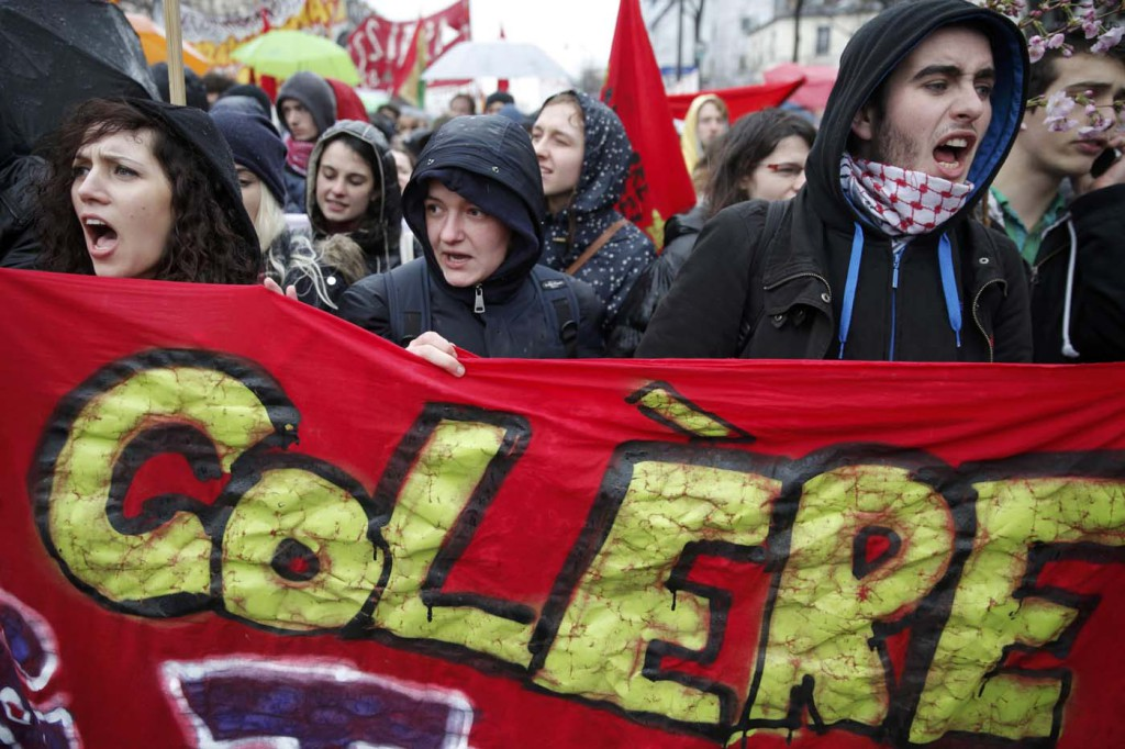 "French high school and university students attend a demonstration against the French labour law proposal in Paris, France, as part of a nationwide labor reform protests and strikes, March 31, 2016. The slogan reads ""Angry"". REUTERS/Christian Hartmann - ATTENTION EDITORS FRENCH LAW REQUIRES THAT FACES OF MINORS ARE MASKED BY PUBLISHERS"